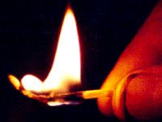 Hand with Lit Match