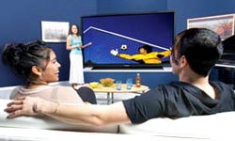 Couple Watching Panasonic HDTV/Blu-ray Player