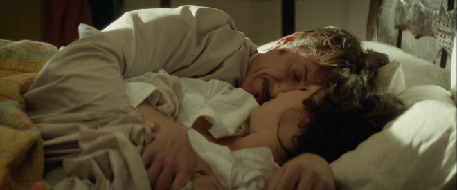 Jim and Annie in bed in THE GUNMAN